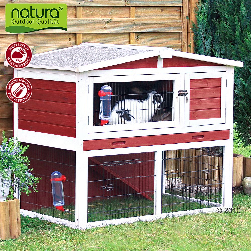 The red and white Natura rabbit hutch from Trixie will add a colourful focal point to your garden