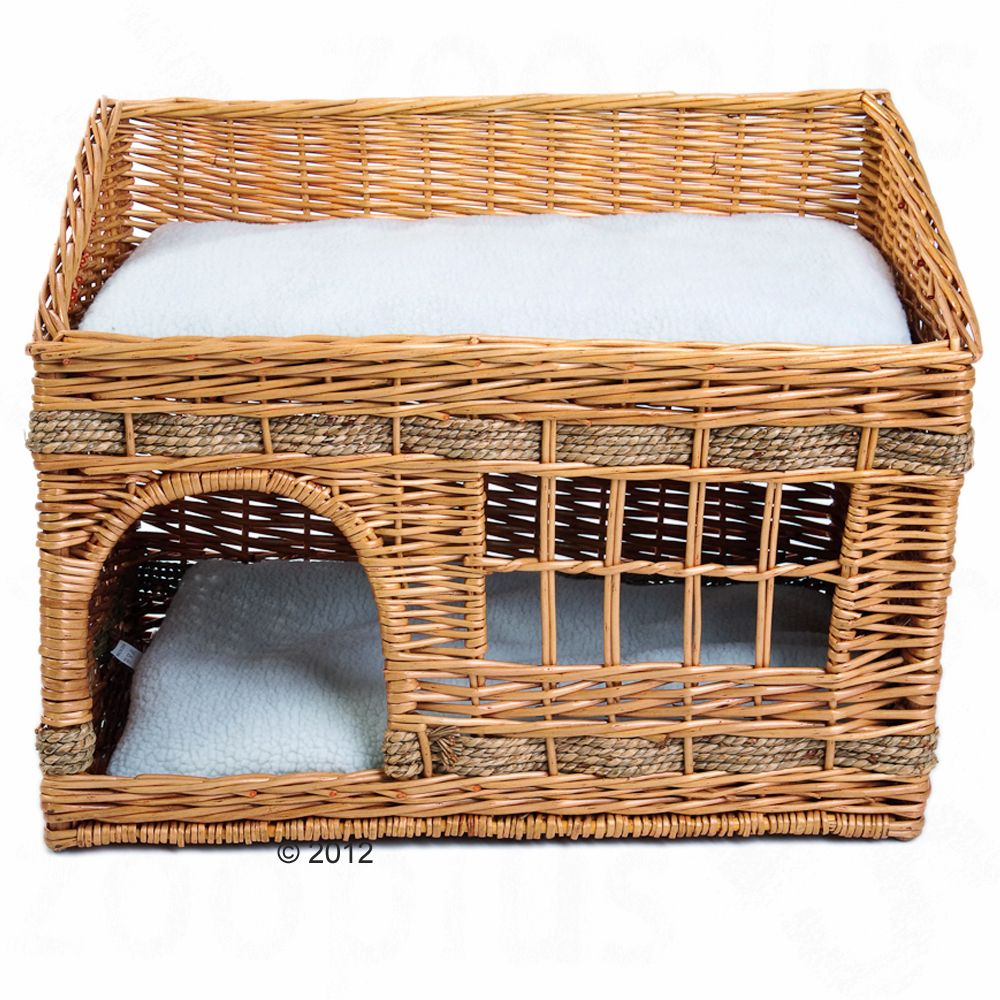This extravagant and elaborately woven cat den made in a stylish Puebloan design has two floors the lower floor is a snuggle den with a window for hiding and observing the territory