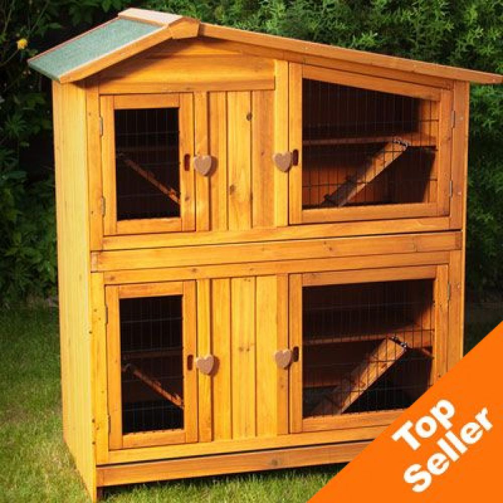 The Outback Two-Story Apartment Hutch is a two-story wooden pet hutch made with quality workmanship
